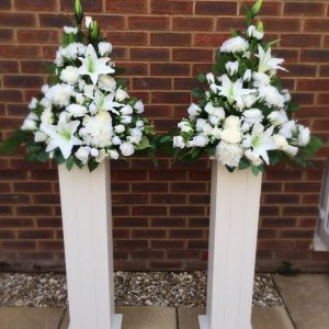 White Pedestal & Artificial Floral Arrangement.