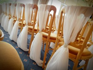Ivory chiffon chair drape hire devon